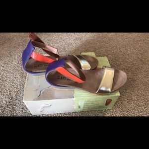 Size 39 gold, purple, and orange Naot shoes